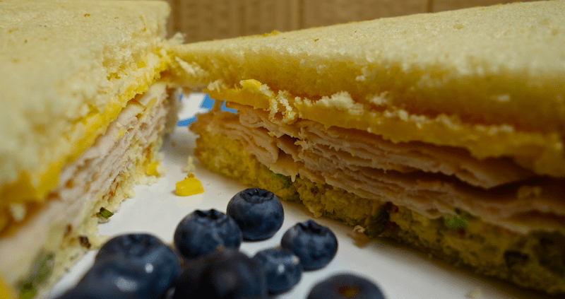 turkey, cheese and knorr spread sandwich with blueberries