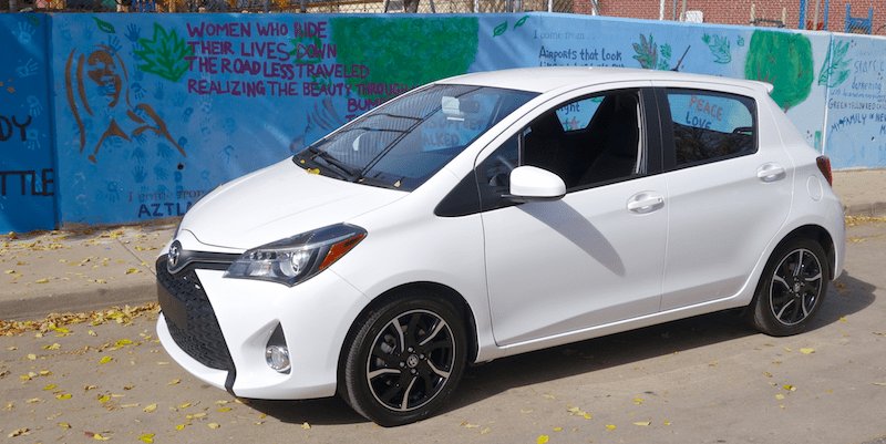 toyota yaris in front of mural, denver co