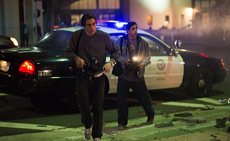 "Lou (Gyllenhaal) and Rick (Riz Ahmed) on the scene, from the film ""Nightcrawler""."