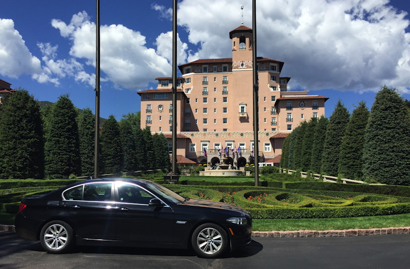 black bmw 528xi 528i in front the broadmoor hotel