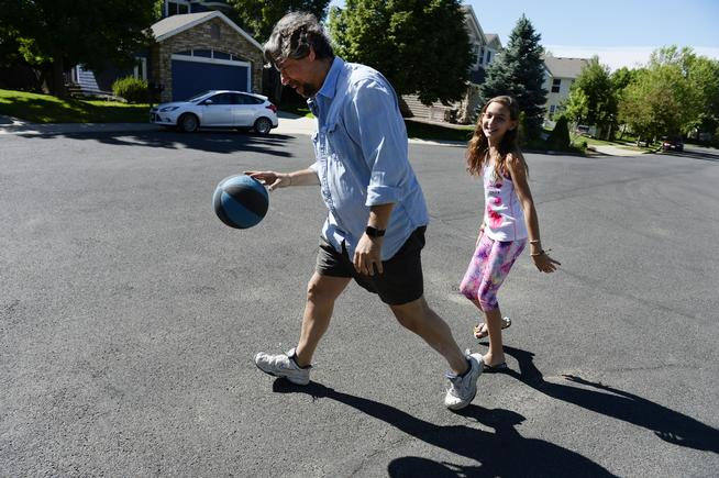 K- and I shoot hoops in the driveway