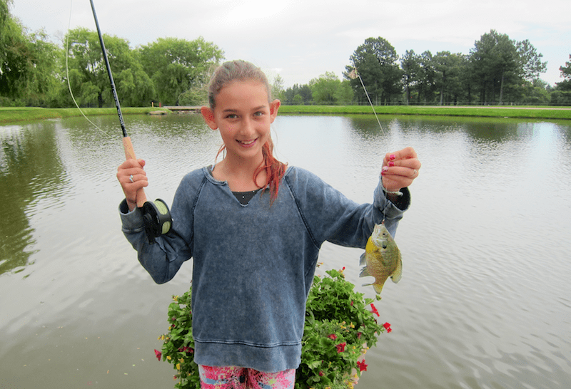 girl with fish, broadmoor fly fishing camp