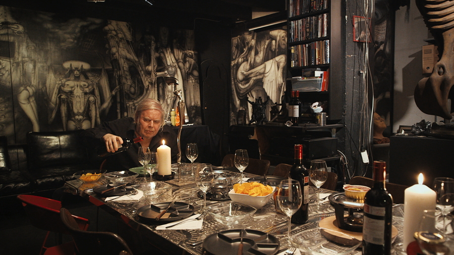 "The artist Hans Giger surrounded by some of his surreal artwork, from ""Dark Star: H. R. Giger's World"""