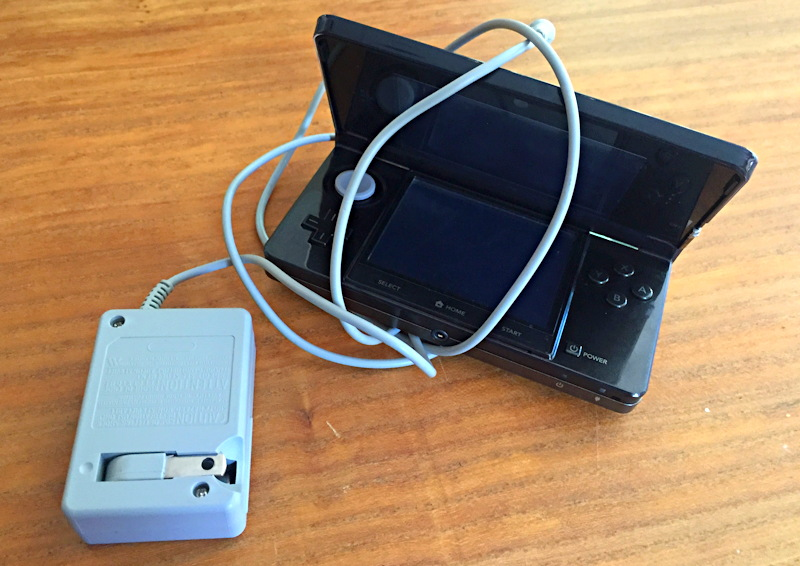 nintendo 3ds gameboy player wrapped in power cord