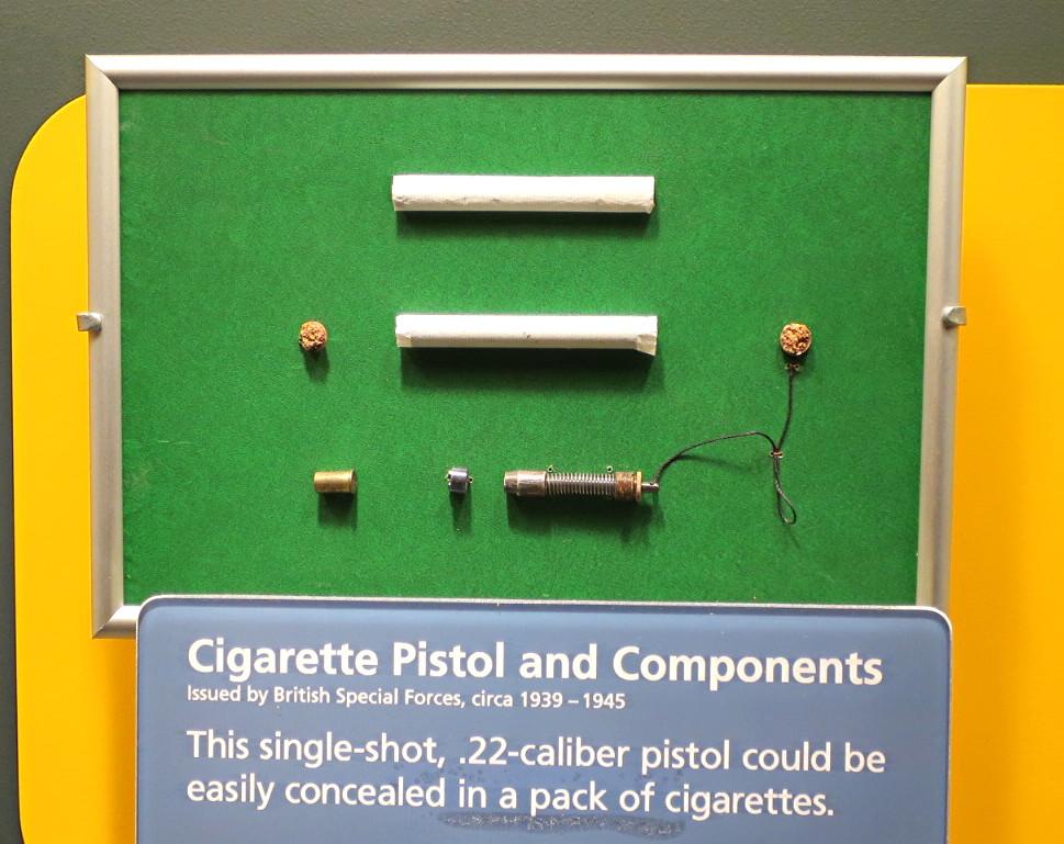 cigarette gun with bullet, cold war spy espionage