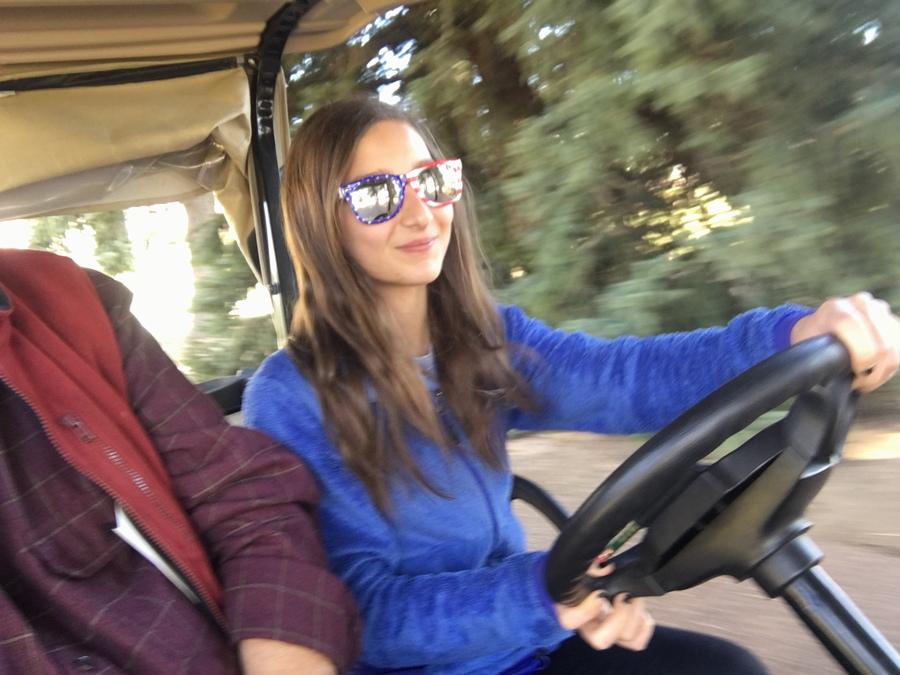 girl driving golf cart, the broadmoor