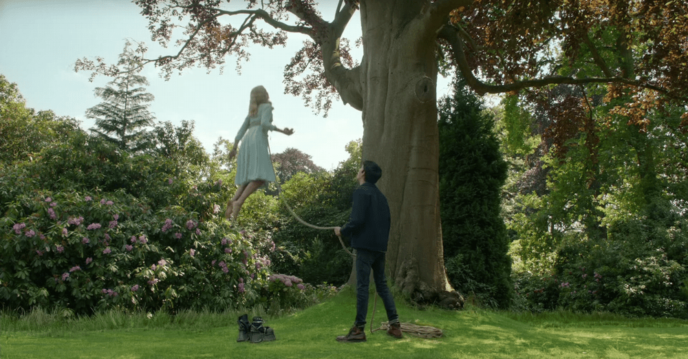 """Jacob () keeps Emma () from floating away, from """"Miss Peregrine's Home for Peculiar Children"""""""
