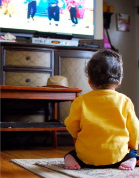 child glued to tv screen