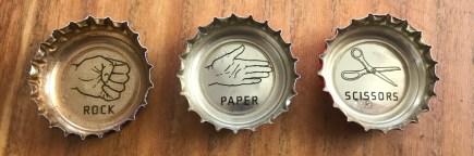 rock paper scissors beer caps