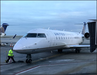 unaccompanied minor child flying alone pick up at airport dia denver flight plane