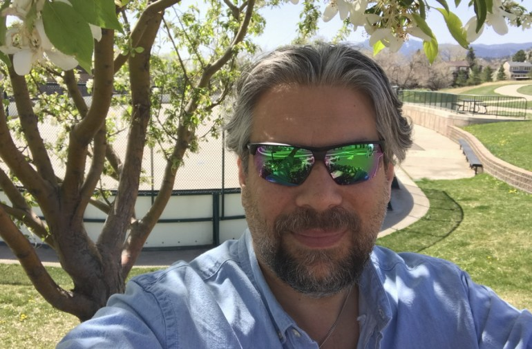 dave taylor wearing native hardtop ultra xp with green / blue lenses