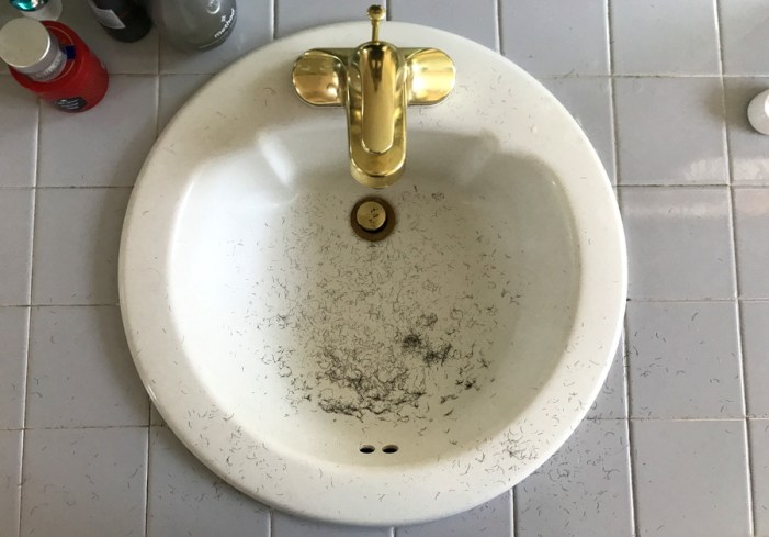 bathroom sink with hair shaving stubble dirty mess