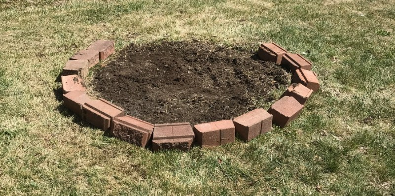 bricks start to define the garden bed edge
