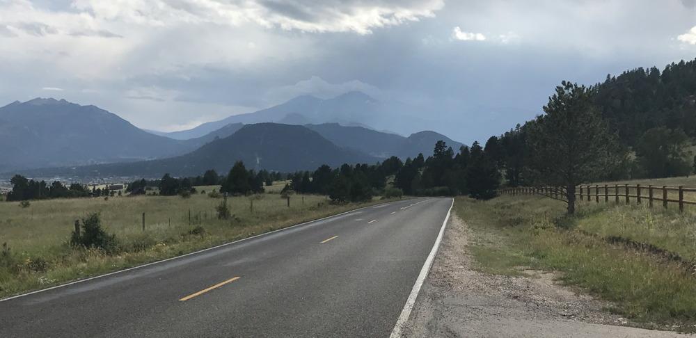 a road in the mountains, estes park, colorado