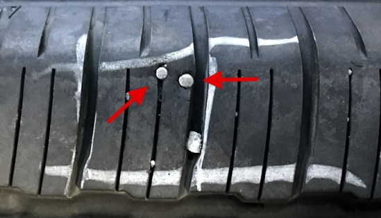 tire with nails
