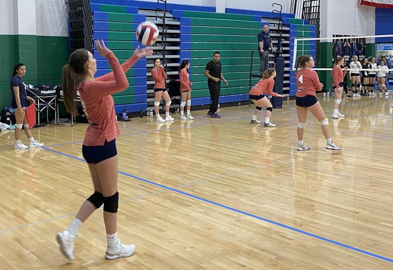 girl serving, club volleyball, colorado