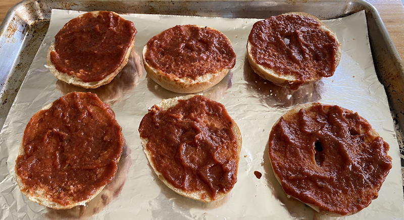 pizza bagels - sauce on bagels