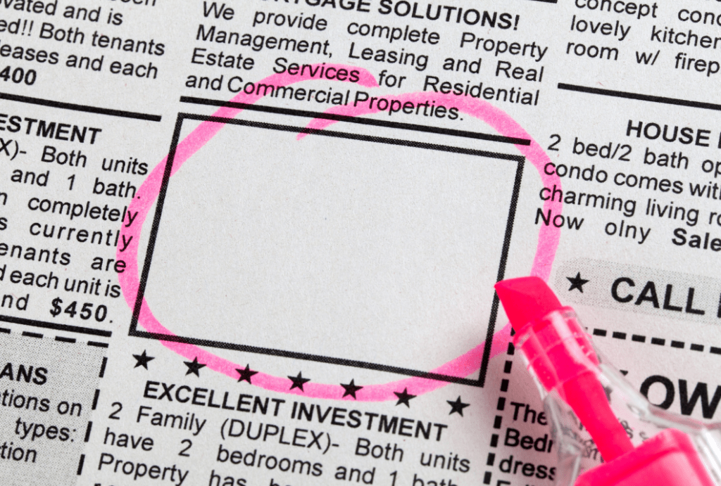 zoom-in of newspaper classifieds with a missing photo circled by pink highlighter