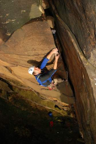 Jon Winter on Bulls Crack HVS 5a at Heptonstall Quarry England UK - Jon Winter laybacking the wide crack of Bulls Crack.  Quarried Gritstone like Heptonstall in Yorkshire offers more positive climbing the natural grit's traditionally sloping routes.