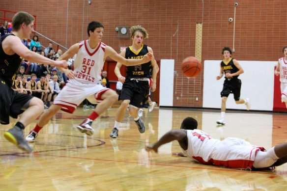 Dawson County High School Boys Basketball Loose Ball Feb. 13, 2015. Copyright Go Gonzo Journal.