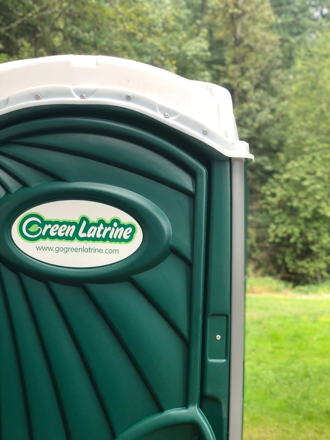 Close up picture of a Green Latrine and some pacific northwest greenery