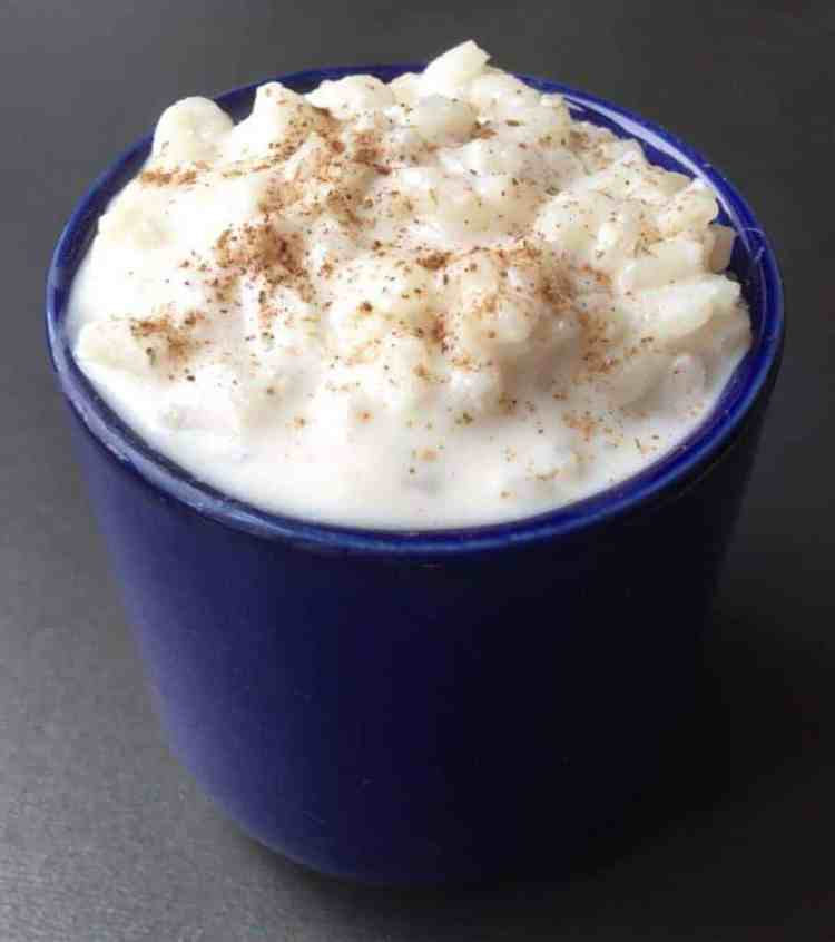 Rice pudding in a blue mug