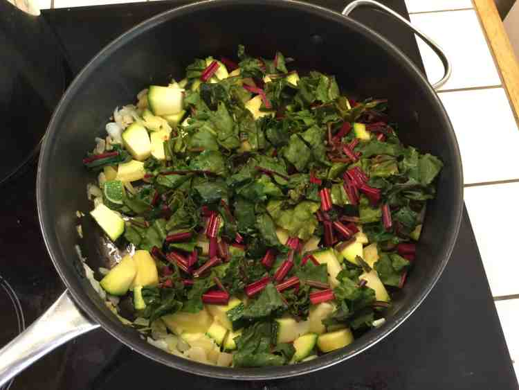 Beetroot leaves and stalks in a frying pan