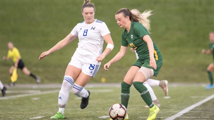 UBCO's Stefanie Young battles for possession against the Pandas on Saturday afternoon in Edmonton (Photo Credit: Don Voaklander)