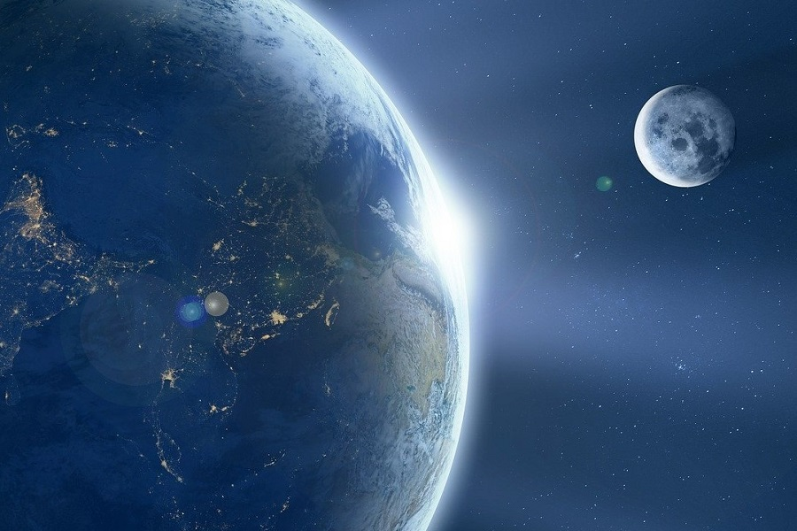Earth and Moon, backlit by the Sun