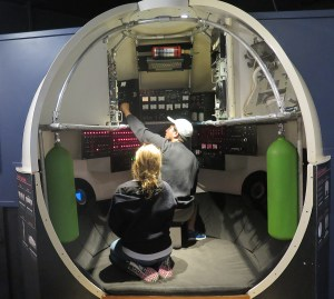 Dive, dive, dive: pretending to pilot ALVIN at the WHOI exhibit center in Woods Hole © 2016 Karen Rubin/news-photos-features.com