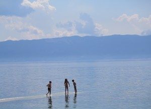 Kids playing on Lake Ohrid © 2016 Karen Rubin/goingplacesfarandnear.com