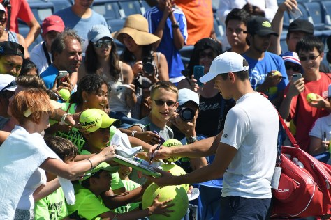 Fans flock to Milos Raonic after his practice in the Louis Armstrong Stadium; fans will get to say a final farewell to the stadium on Sept. 8 © 2016 Karen Rubin/news-photos-features.com