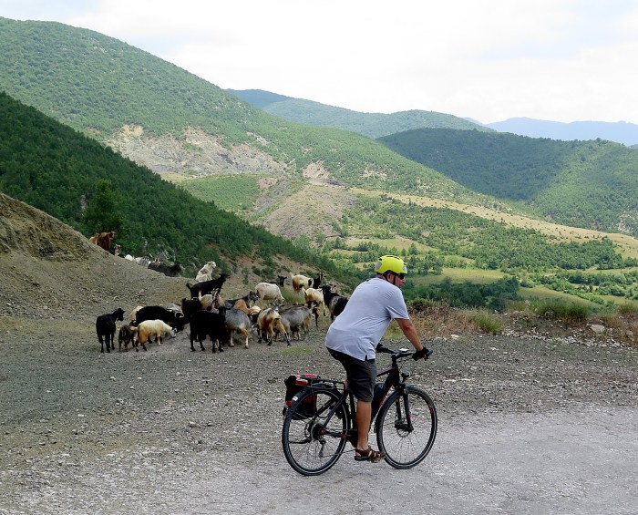 BikeTours.com President Jim Johnson biking in Albania on an e-bike. © 2016 Karen Rubin/goinplacesfarandnear.com