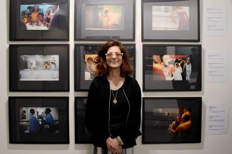 Maxi Cohen with part of her photographic series, 'Ladies Rooms Around the World' © 2016 Karen Rubin/goingplacesfarandnear.com