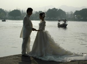 """Hangzhou is the """"City of Love"""": a bridal couple poses for pictures beside West Lake © 2016 Karen Rubin/goingplacesfarandnear.com"""