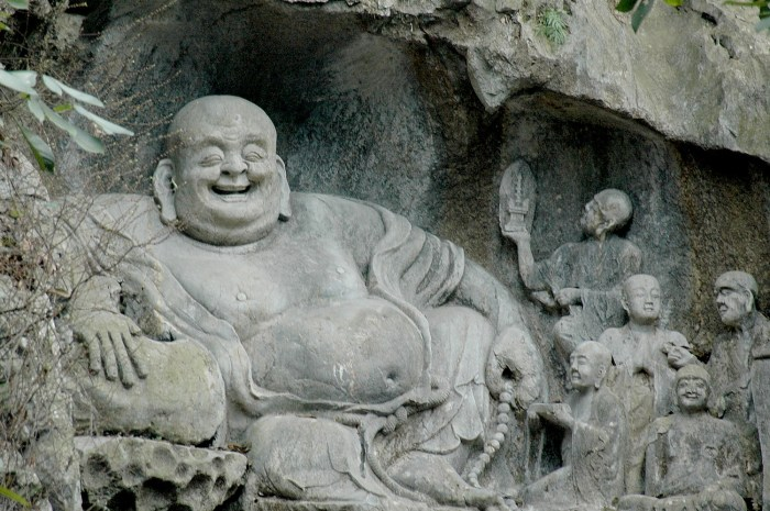 The Laughing Budda, one of 340 statues in the limestone on Feilai Peak – the Peak Flying From Afar - at Lingyin Temple © 2016 Karen Rubin/goingplacesfarandnear.com