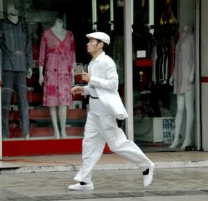 A fashionable man struts down Wulin Road, Hangzhou's 'Fashion Avenue.' The city manifests old & new © 2016 Karen Rubin/goingplacesfarandnear.com