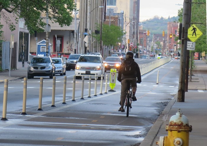 Biking on a dedicated lane in Pittsburgh © 2016 Karen Rubin/goingplacesfarandnear.com