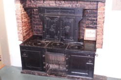 A Moses Pond woodstove adapted from a clipper ship into a home.