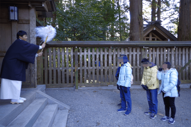 To a hidden sacred spot guided by shinto priest