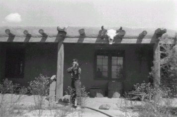 Brian Garfield in Ghost Ranch Courtyard, c. 1949 Frances O'Brien Frances O'Brien Papers, Georgia O'Keeffe Museum Gift of Brian and Bina Garfield in honor of Frances O'Brien (2015-01-011) Copyright Georgia O'Keeffe Museum