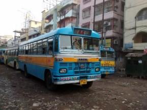 Rustic blue city busses