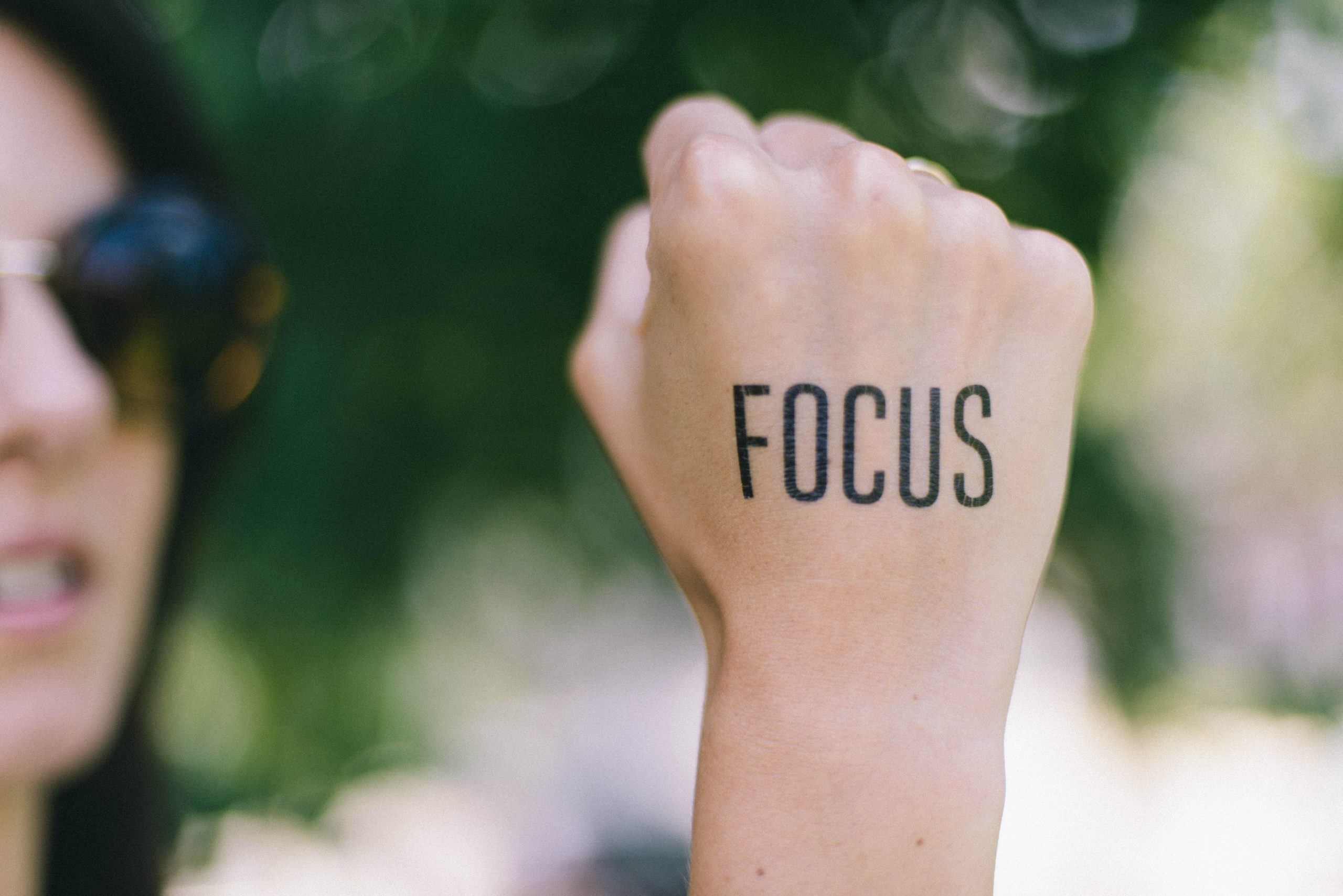 woman holding fist with focus written on it