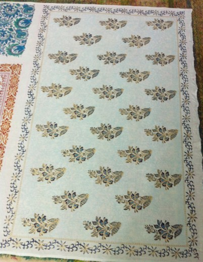 A beautiful 4-colour buta with a half-drop repeat background and border.