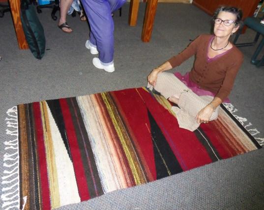 Vilasa on her handwoven floor rug