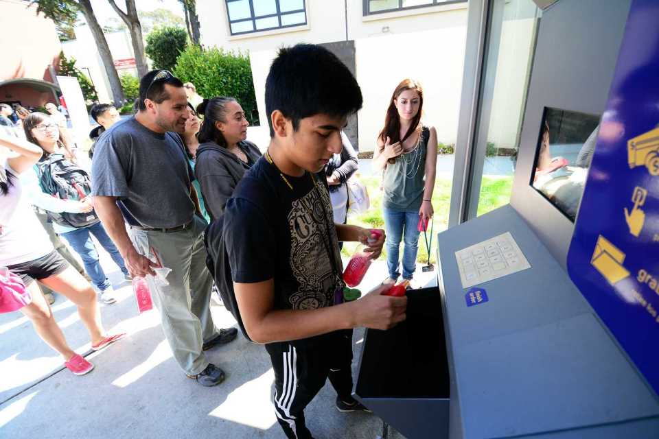 Jasson Soto, freshman, pulls his new deodorant out of a bin during the Shop 24 Grand Opening at SF State on Friday, Sept. 6, 2013. Shop 24 is the first automated convenience store in the Bay Area. Photo by Philip Houston / Xpress