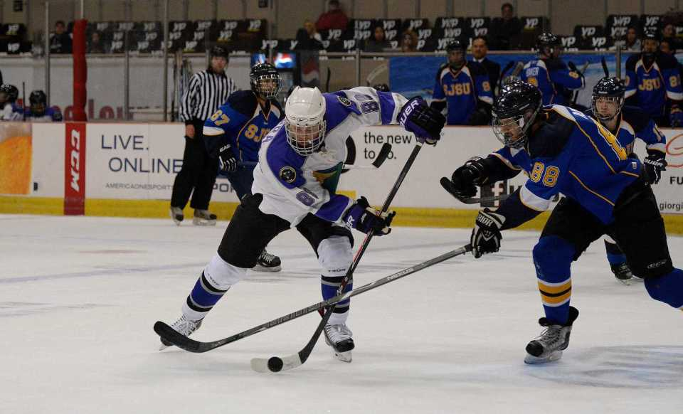 SF State Gators' Michael Parra (88) fights with San Jose State Spartans' Trevor Addison (88) for control of the puck during an ice hockey game at the Cow Palace in Daly City, Calif., on Friday, Nov. 8, 2013. The Gators won the home opener 9-0. Photo by Philip Houston / Xpress