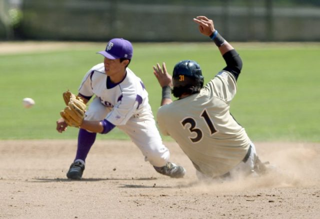 SF State's Joe Chedid misses the tag as Cal State L.A. Drew Vanisi slides to second base during the Gators game against the Golden Eagles, at SF State's Maloney Field Sunday, April 13th. Photo by Gavin McIntyre / Xpress