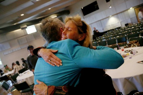 Outgoing Dean of Students Joseph Greenwall hugs Tina Marie Rossi, the aquatic fitness and wellness coordinator, at a farewell event in his honor in Jack Adams Hall in the Cesar Chavez Center at SF State Tuesday, April 22. Photo by Rachel Aston / Xpress