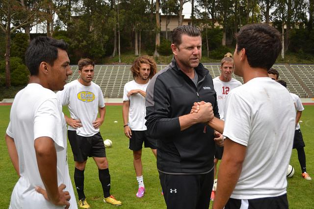 New men's soccer coach Matt Barnes interacts with members of the team on Friday, Aug. 29. Helen Tinna / Xpress